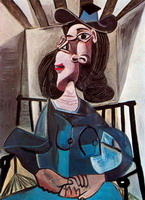 Woman with a hat sitting in a chair (Dora Maar)